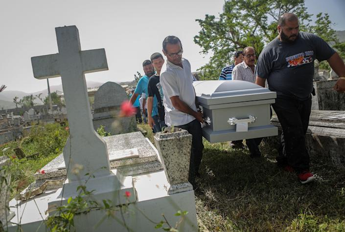 Mourners carry the coffin of Wilfredo Torres Rivera, 58, who died in October 2017 after jumping off a bridge into a lake three weeks after Hurricane Maria hit Puerto Rico. Wilfredo's family said he suffered from depression and schizophrenia and was caring for his 92-year-old mother in a home without electricity or water. (Photo: Mario Tama via Getty Images)
