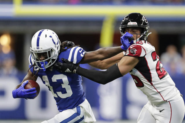 Indianapolis Colts wide receiver T.Y. Hilton (13) is tackled by Atlanta Falcons cornerback Isaiah Oliver (26) during the first half of an NFL football game, Sunday, Sept. 22, 2019, in Indianapolis. (AP Photo/Michael Conroy)
