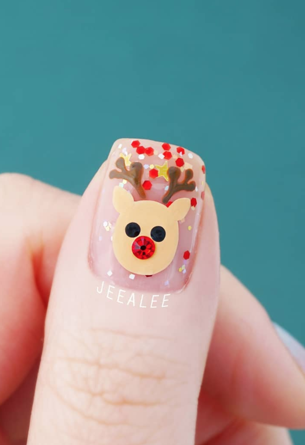 "<p>Try putting your own spin on this adorable Rudolph the Red-Nosed Reindeer nail art by <a href=""https://www.instagram.com/jeealee/"" rel=""nofollow noopener"" target=""_blank"" data-ylk=""slk:Stephanie"" class=""link rapid-noclick-resp"">Stephanie</a> with the help of a simple-to-use stencil.</p><p><a class=""link rapid-noclick-resp"" href=""https://go.redirectingat.com?id=74968X1596630&url=https%3A%2F%2Fwww.etsy.com%2Flisting%2F566039672%2Fstag-head-nail-stencils-vinyl-stencils&sref=https%3A%2F%2Fwww.oprahmag.com%2Fbeauty%2Fg34113691%2Fchristmas-nail-ideas%2F"" rel=""nofollow noopener"" target=""_blank"" data-ylk=""slk:SHOP REINDEER STENCIL"">SHOP REINDEER STENCIL</a></p>"
