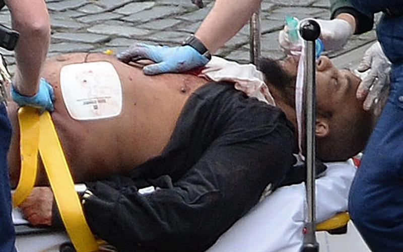 The Westminster car and knife attacker, seen here receiving emergency treatment from paramedics, has been named as Khalid Masood - PA