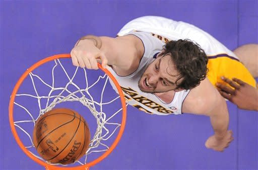 Los Angeles Lakers forward Pau Gasol of Spain dunks during the first half of their NBA basketball game against the Indiana Pacers, Sunday, Jan. 22, 2012, in Los Angeles, Calif. (AP Photo/Mark J. Terrill)