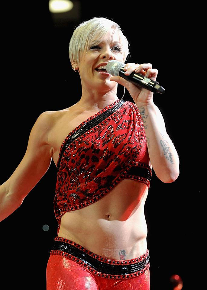 "Pink has joked that she has ""man abs,"" saying, ""I get a lot of flak for it. That's where the masculine thing comes in, people saying it's not normal for a girl to have [those]. But I'm OK with it. I think it's because I was a gymnast for eight years, from ages 4 to 12."" She maintains her abs with an intense, six-days-a-week workout that combines an hour of cardio, an hour of yoga or P90X, and a half-hour show warm-up."