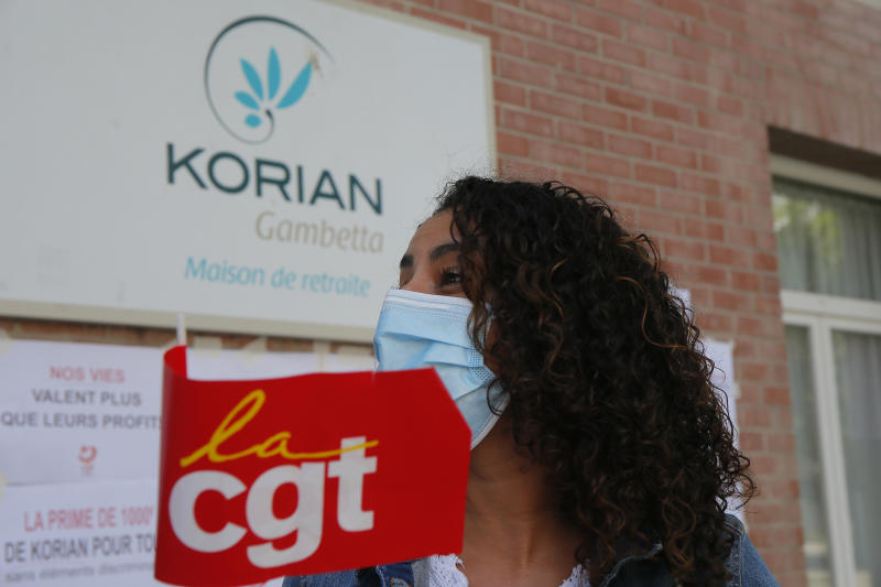 Employees demonstrate outside a nursing home of the Korian group, one of the market leaders in the lucrative industry of providing care and assisted living facilities for older adults, Monday, May 25, 2020 in Lille, northern France. In France, the group is facing several lawsuits filed by families who have lost loved ones during the coronavirus pandemic that has caused thousands of deaths in French care homes. (AP Photo/Michel Spingler)