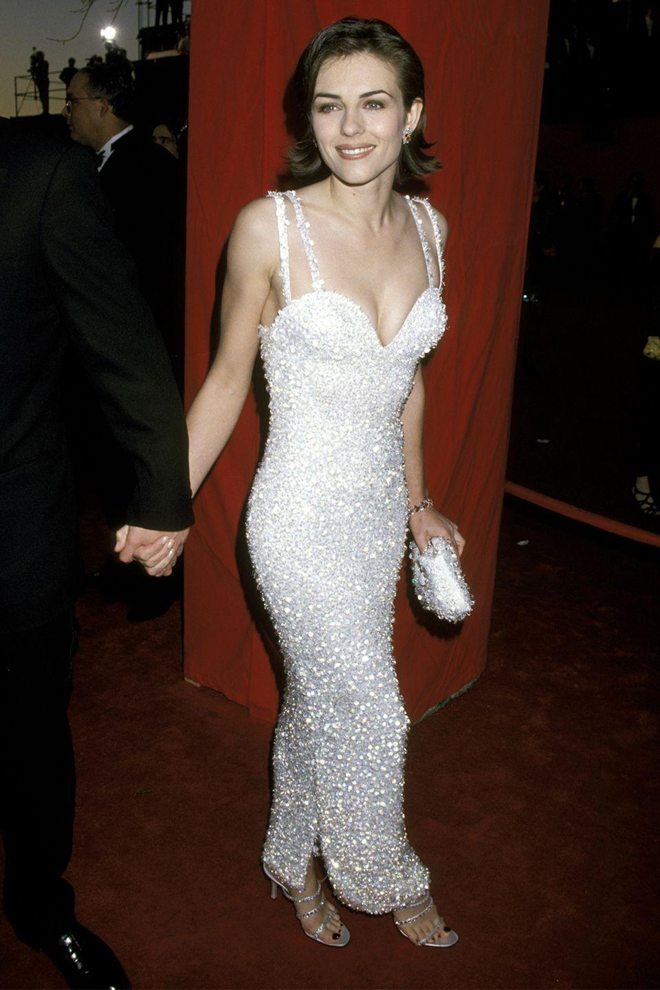 <p>Elizabeth Hurley was the quintessential Versace girl, the model and actress stole the show in this sparkling curve-hugging dress. </p>
