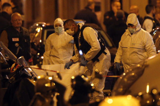 <p>Scientific police officers investigate after a knife attack in central Paris, Saturday May 12, 2018. (Photo: Thibault Camus/AP) </p>