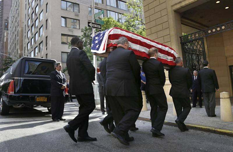 The casket containing the body of U.S. Sen. Frank Lautenberg is carried into the Park Avenue Synagogue in New York, Wednesday, June 5, 2013. Lautenberg's nearly three decades in office and the causes he championed will be remembered at a funeral service in New York. (AP Photo/Seth Wenig)