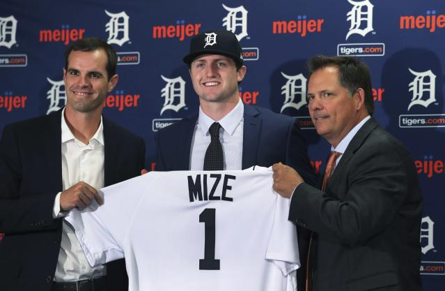 FILE - In this June 25, 2018, file photo, Detroit Tigers first overall pick Casey Mize, center, stands with Tigers scout Justin Henry, left, and Scott Pleis, director of amateur scouting, during a news conference where he was introduced to the media, in Detroit. Most of the team's top prospects are pitchers. (AP Photo/Carlos Osorio, File)