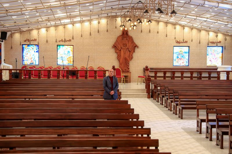 Thanoun Yahya, a 59 year-old an Iraqi Christian from the city of Mosul, stands at Al-Bishara church in Mosul