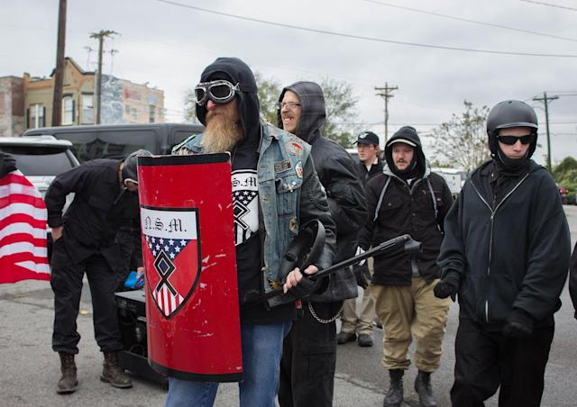 """<p>A member of the National Socialist Movement holds a shield and a microphone stand before a """"White Lives Matter"""" rally in Shelbyville, Tenn., on Oct. 27, 2017. (Photo: Emily Molli/NurPhoto via Getty Images) </p>"""