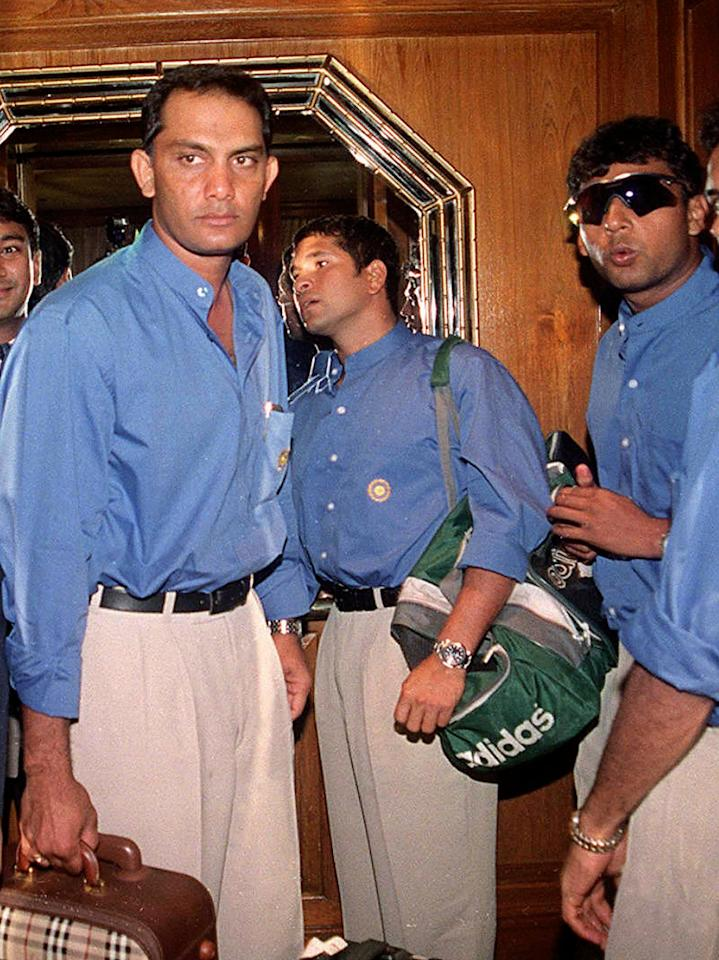 DHAKA, BANGLADESH - MAY 28:  Indian cricket stars (L to R) Mohammad Azharuddin, Sachin Tendulkar and (sun glass) on arrival at Dhaka's Sheraton Hotel 28 May 2000, after a flight from New Delhi to play in the rain-hit four-nation Asia Cup cricket. Incessant rain disrupted the start of the 10-day limited-overs tournament on Sunday amid fears the entire event may be washed out. Besides India and host Bangladesh the Asia Cup include Sri Lanka and Pakistan.  (Photo credit should read MUFTY MUNIR/AFP/Getty Images)
