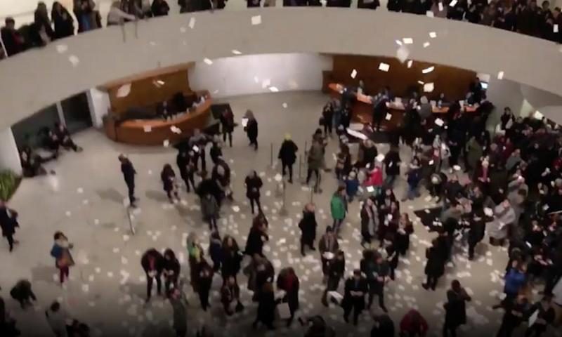 Pieces of paper are strewn during a protest against the Sackler family at the Guggenheim Museum in New York on Saturday.