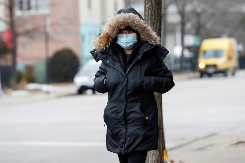 FILE PHOTO: A woman wears a mask following the outbreak of the novel coronavirus, in Chicago