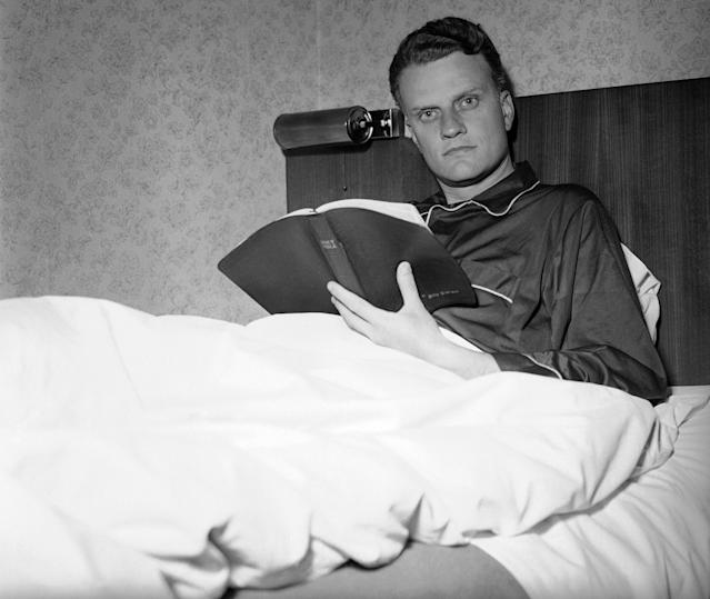 <p>Billy Graham rests in bed at Düsseldorf, Germany, June 25, 1954, after being stricken by a sudden kidney ailment. He was able to travel to Berlin on June 26 to address 140,000 West Berliners on June 27. (Photo: AP) </p>