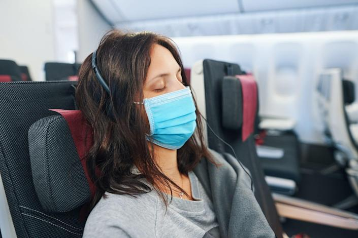 When passengers don't arrive with masks, airlines often hand out surgical masks like the one in this photo.