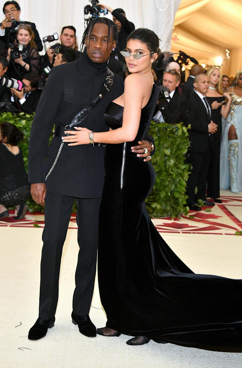 d398bc05ab3d Travis Scott in Christian Louboutin shoes and Kylie Jenner in Alexander  Wang and Chopard jewelry