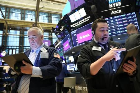 Traders work on the floor during The Slack Technologies Inc. IPO at the New York Stock Exchange (NYSE) in New York