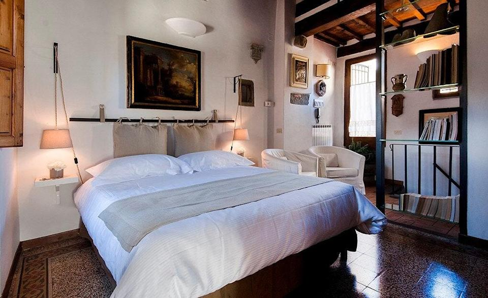 """If you're the type that just wants a place to lay your head after hours and hours of walking tours, museum adventures, and nights out, this is your kind of Airbnb. A petite studio with lots of character—and a spacious private outdoor patio with Duomo views—it's the kind of place to drop your bags and go. Expect to eat most meals out unless you want to get particularly creative with the limited kitchenette. $162, Airbnb (Starting Price). <a href=""""https://www.airbnb.com/rooms/967238/"""" rel=""""nofollow noopener"""" target=""""_blank"""" data-ylk=""""slk:Get it now!"""" class=""""link rapid-noclick-resp"""">Get it now!</a>"""