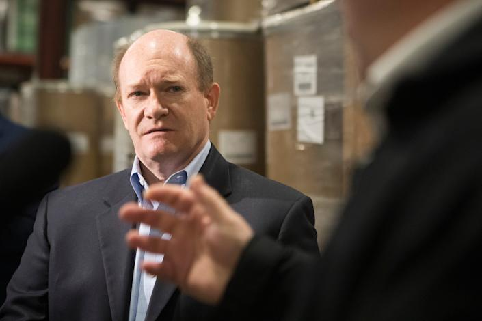 Sen. Chris Coons speaks to the media about the arrival of nearly 500,000 disposable face masks Tuesday morning at D&S Wharehousing Inc. in Newark, Delaware.