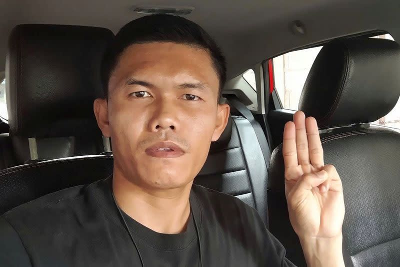 Former Thai Army Sergeant Ekkachai Wangkaphan poses with the three-fingered salute of anti-government protesters in this image he took in Bung Kan, Thailand