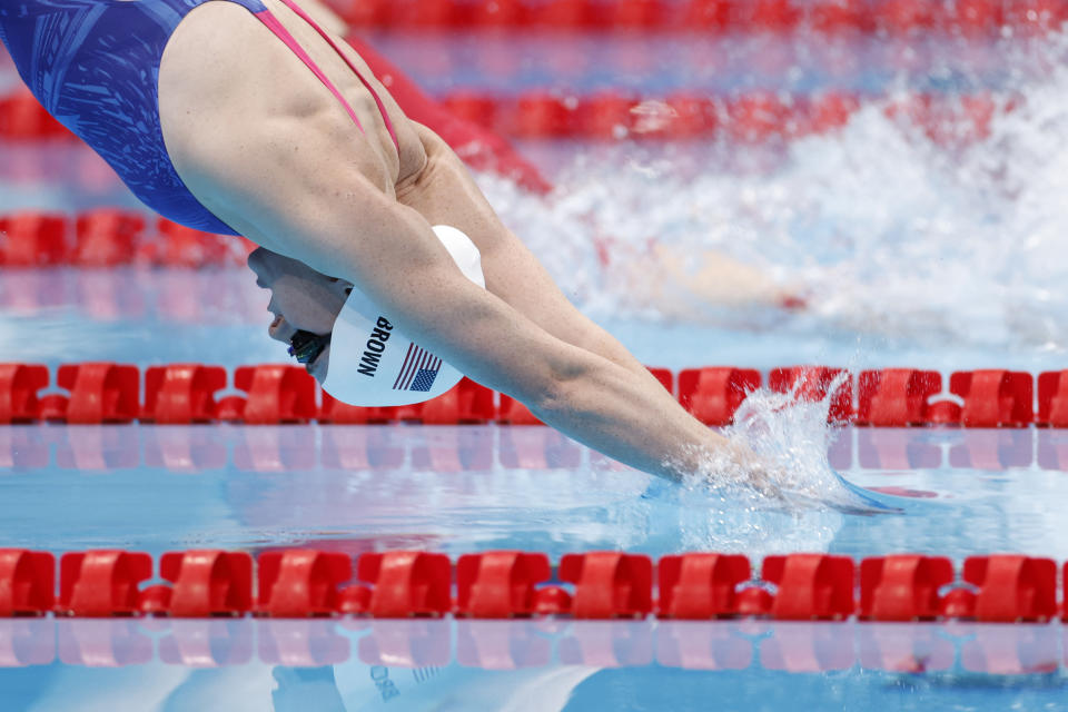 <p>USA's Erika Brown (L) competes to win against China's Wu Qingfeng in a swim-off for the women's 4x200m freestyle relay swimming event during the Tokyo 2020 Olympic Games at the Tokyo Aquatics Centre in Tokyo on July 28, 2021. (Photo by Odd ANDERSEN / AFP) (Photo by ODD ANDERSEN/AFP via Getty Images)</p>