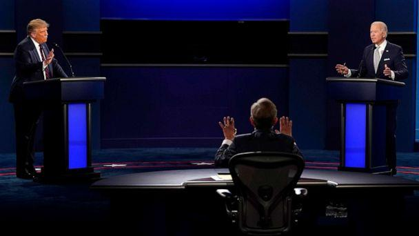 PHOTO: Chris Wallace of Fox News tries to moderate as President Donald Trump and Democratic candidate former Vice President Joe Biden both speak during the first presidential debate, Sept. 29, 2020, in Cleveland. (Patrick Semansky/AP)