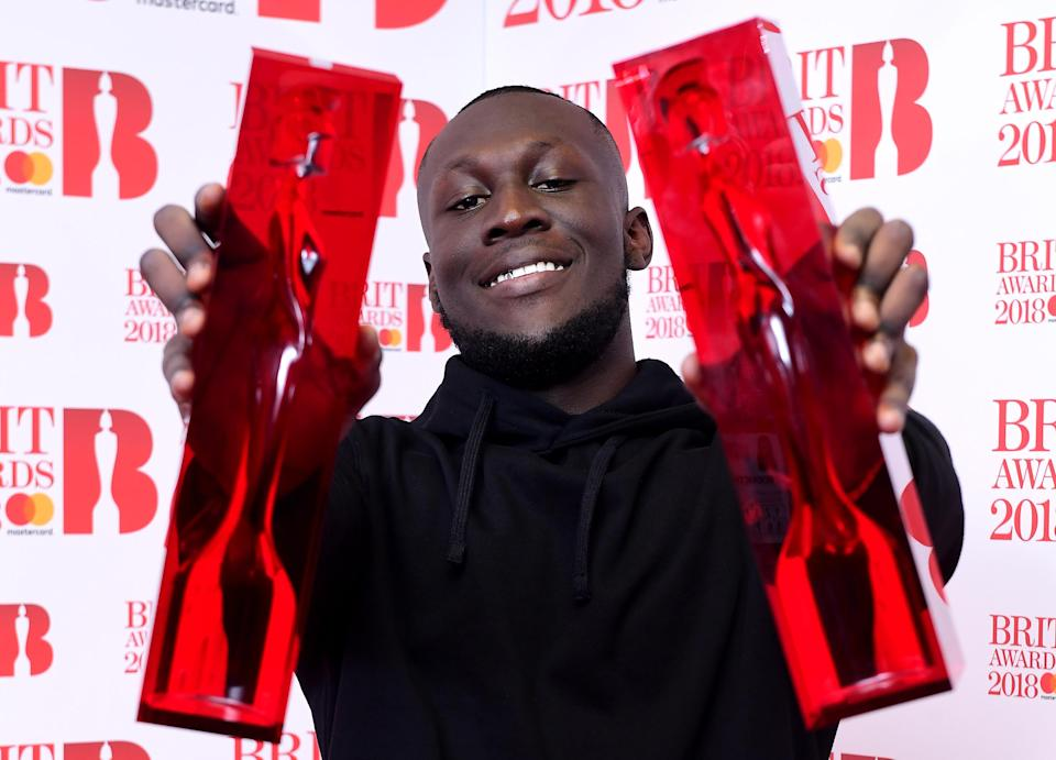 Stormzy with his British Album of the Year and British Male Solo Artist awards in the press room during the Brit Award. (PA)