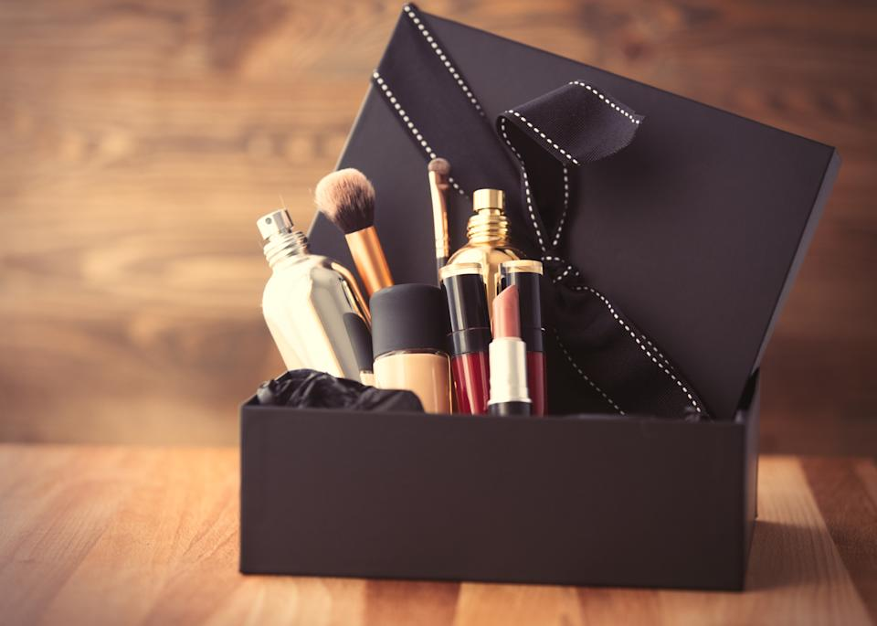 Vintage cosmetic bottles in gift box on wooden background