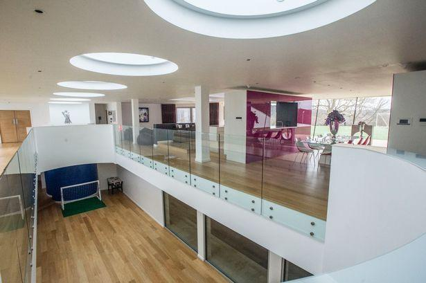 <p>Living areas in the 13,627-square-foot home span four floors, with most of the house underground. High ceilings, split levels and skylights allow sunshine to penetrate the lower levels.<br></p>
