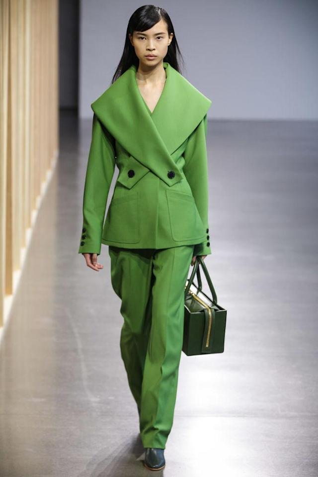 <p>Model wears a green pantsuit at the fall 2018 Claudia Li show. (Photo: Getty Images) </p>