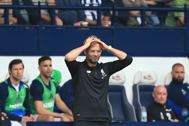 Liverpool manager Jurgen Klopp at times bemoaned the subdued atmosphere in modern English grounds, even at the mythical Anfield, compared to his grounding in Germany's Bundesliga (AFP Photo/Lindsey PARNABY)