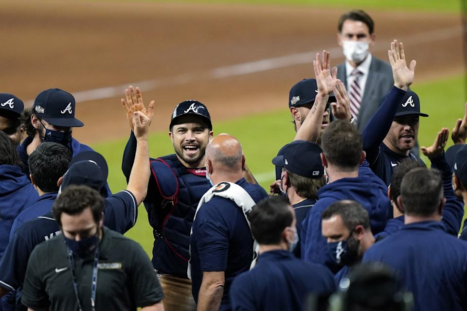 Atlanta catcher Travis d'Arnaud celebrates with teammates after the Braves defeated the Miami Marlins in Game 3 of their NLDS