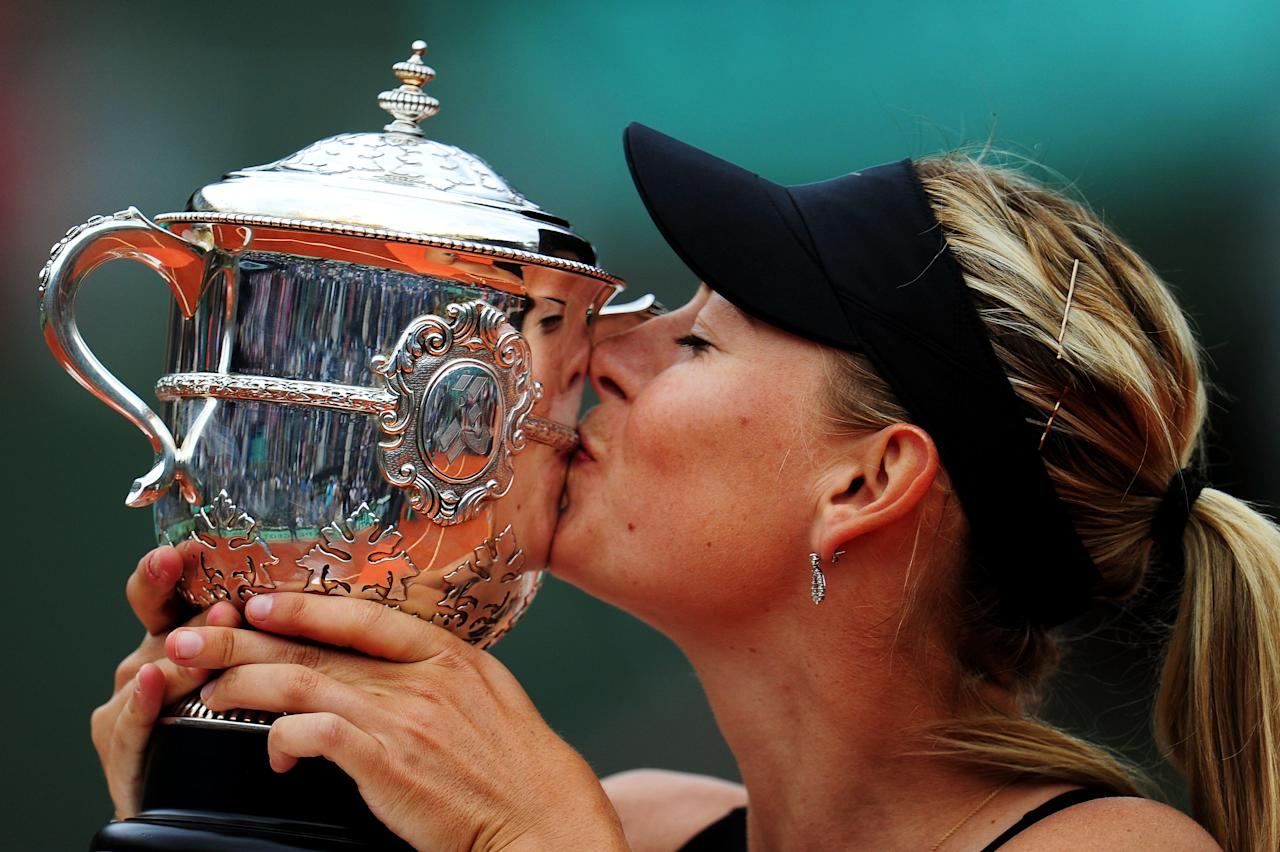 PARIS, FRANCE - JUNE 09:  Maria Sharapova of Russia kisses the Coupe Suzanne Lenglen in the women's singles final against Sara Errani of Italy during day 14 of the French Open at Roland Garros on June 9, 2012 in Paris, France.  (Photo by Mike Hewitt/Getty Images)