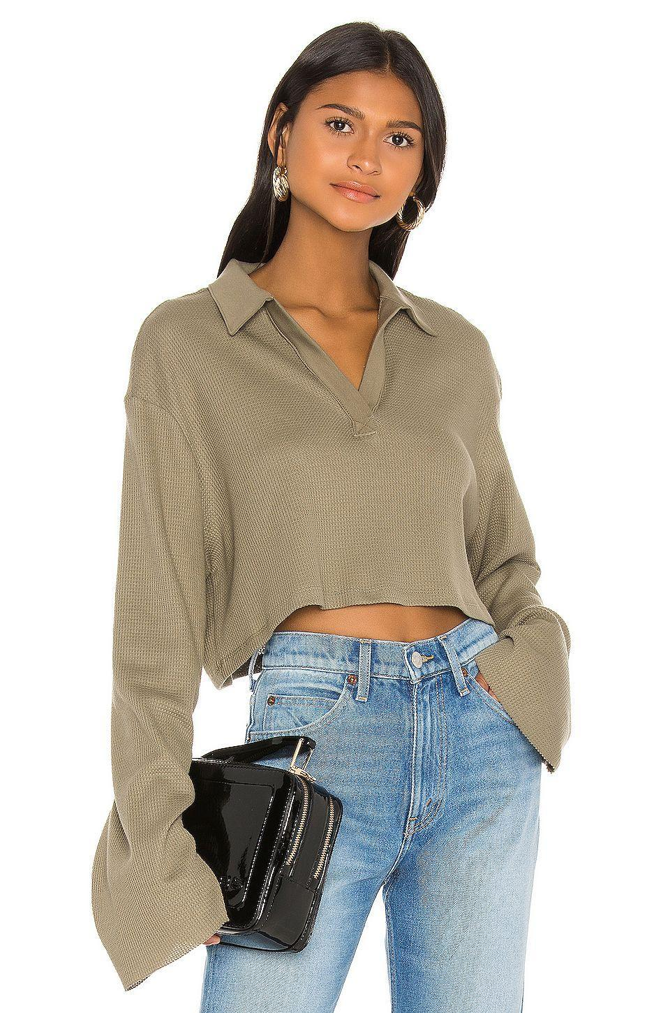 """<p><strong>The Range</strong></p><p>revolve.com</p><p><strong>$165.00</strong></p><p><a href=""""https://go.redirectingat.com?id=74968X1596630&url=https%3A%2F%2Fwww.revolve.com%2Fdp%2FTHRA-WS18%2F&sref=https%3A%2F%2Fwww.cosmopolitan.com%2Fstyle-beauty%2Ffashion%2Fg34043357%2Fzoom-work-from-home-fashion%2F"""" rel=""""nofollow noopener"""" target=""""_blank"""" data-ylk=""""slk:Shop Now"""" class=""""link rapid-noclick-resp"""">Shop Now</a></p><p>Looked elevated but feel comfy in this slouchy soft polo sweater. Throw on some gold hoops and jeans (or leggings, honestly) and you're WFH chic. </p>"""