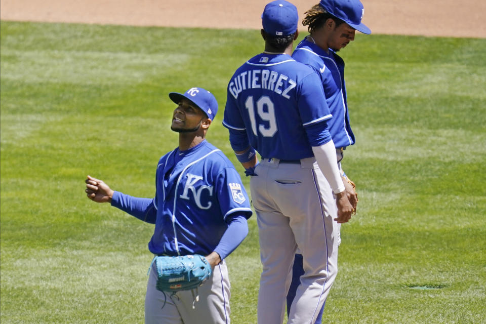 Kansas City Royals pitcher Ervin Santana, left, leaves after being pulled in the fourth inning of a baseball game against the Minnesota Twins, Saturday, May 29, 2021, in Minneapolis. (AP Photo/Jim Mone)