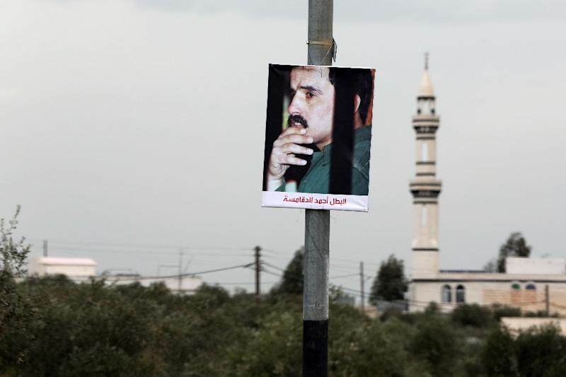A portrait of Ahmad Dakamseh hangs in the Jordanian city of Irbid on the day of his release after serving 20 years in prison