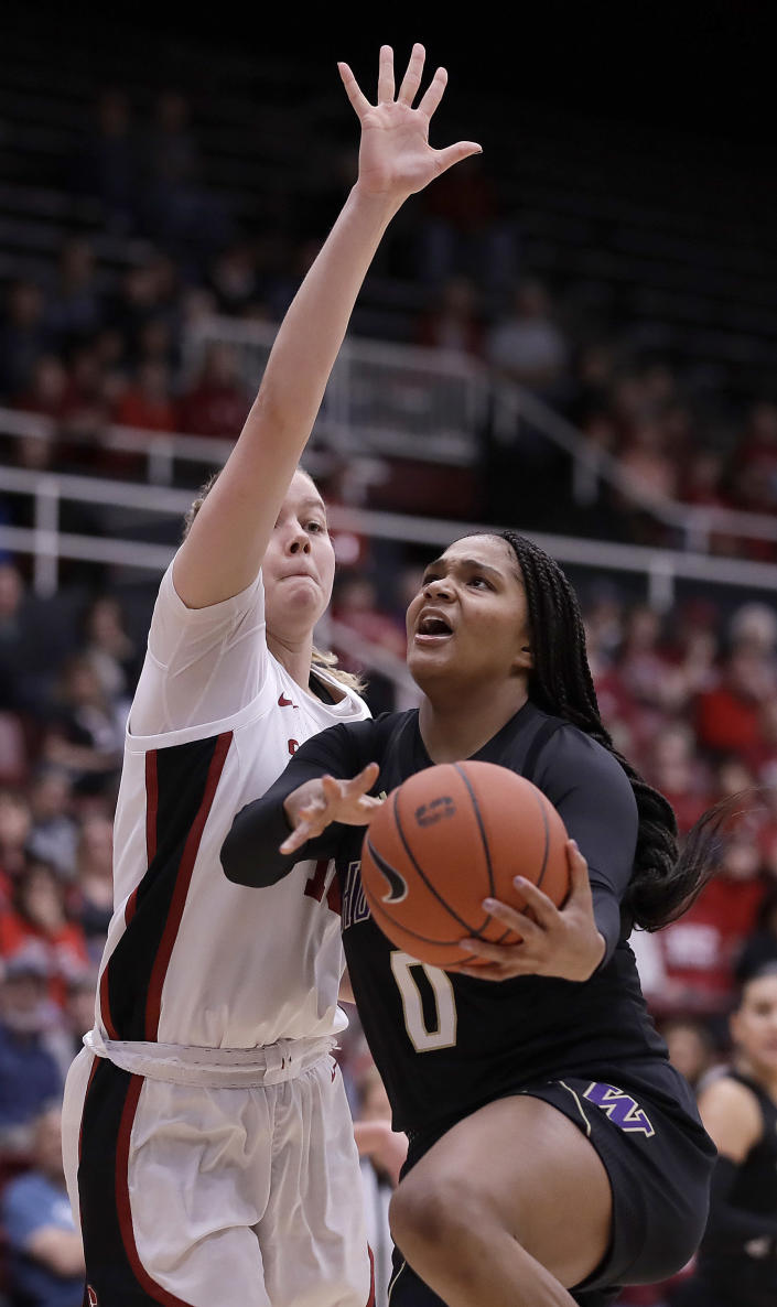 Washington's Quay Miller, right, shoots against Stanford's Alyssa Jerome during the first half of an NCAA college basketball game Sunday, Jan. 5, 2020, in Stanford, Calif. (AP Photo/Ben Margot)
