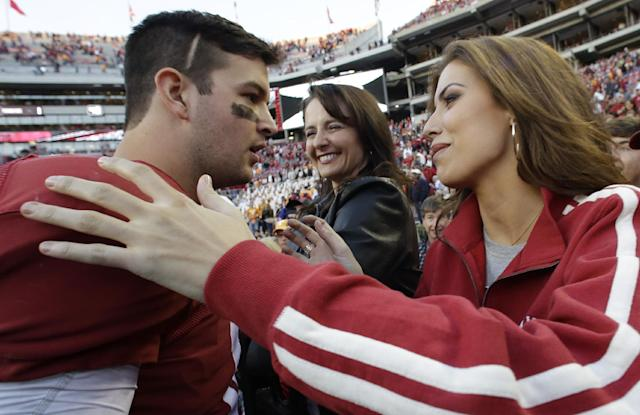 Alabama quarterback AJ McCarron, left, greets his girl friend Katherine Webb, right, as his mother Dee Dee Bonner, center, looks on following a 45-10 win over Tennessee in an NCAA college football game in Tuscaloosa, Ala., Saturday, Oct. 26, 2013. (AP Photo/Dave Martin)