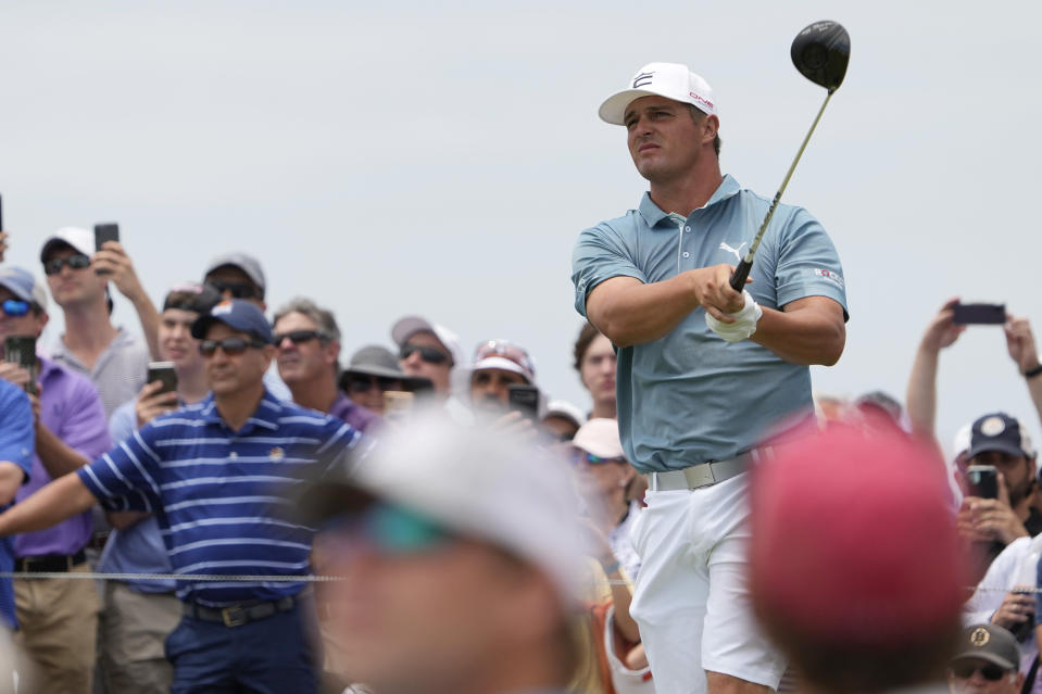 Bryson DeChambeau watches his tee shot on the 14th hole during a practice round at the PGA Championship golf tournament on the Ocean Course Wednesday, May 19, 2021, in Kiawah Island, S.C. (AP Photo/David J. Phillip)