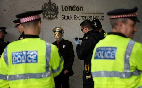The activists have now been removed from the stock exchange - Credit: Matt Dunham/AP