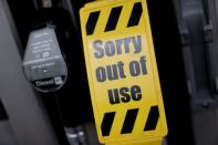 Signs show that unleaded petrol has run out at a fuel station, in Newcastle-under-Lyme