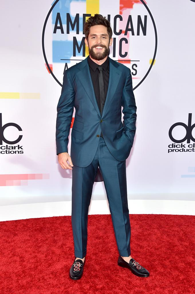 <p>Thomas Rhett attends the 2018 American Music Awards at Microsoft Theater on Oct. 9, 2018, in Los Angeles. (Photo: John Shearer/Getty Images For dcp) </p>