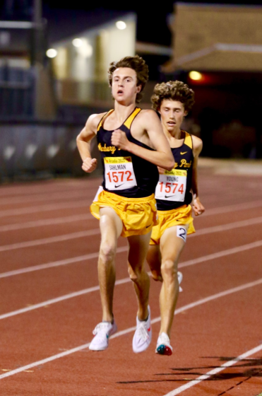 Newbury Park junior Colin Sahlman (left) sprints to the finish line pursued closely by sophomore teammate Lex Young.