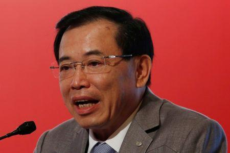 TCL Corporation Chairman Li Dongsheng attends a forum in Hong Kong