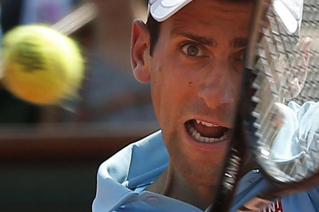 Serbia's Novak Djokovic returns the ball during the final of the French Open tennis tournament against Spain's Rafael Nadal at the Roland Garros stadium, in Paris, France, Sunday, June 8, 2014. (AP Photo/Michel Euler)
