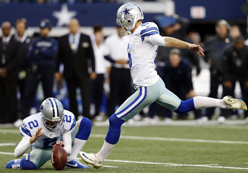 Dallas Cowboys punter Brian Moorman (2) holds as kicker Dan Bailey, right, prepares to make a winning field goal in overtime of an NFL football game against the Cleveland Browns, Sunday, Nov. 18, 2012, in Arlington, Texas. The Cowboys won 23-20. (AP Photo/Sharon Ellman)