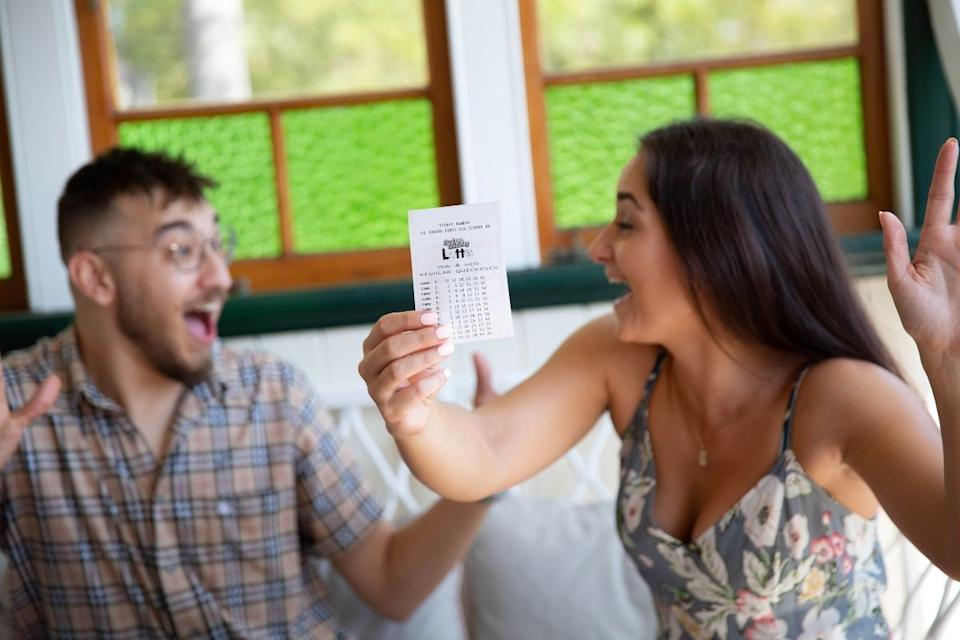 Young couple celebrate lottery win. Source: The Lott