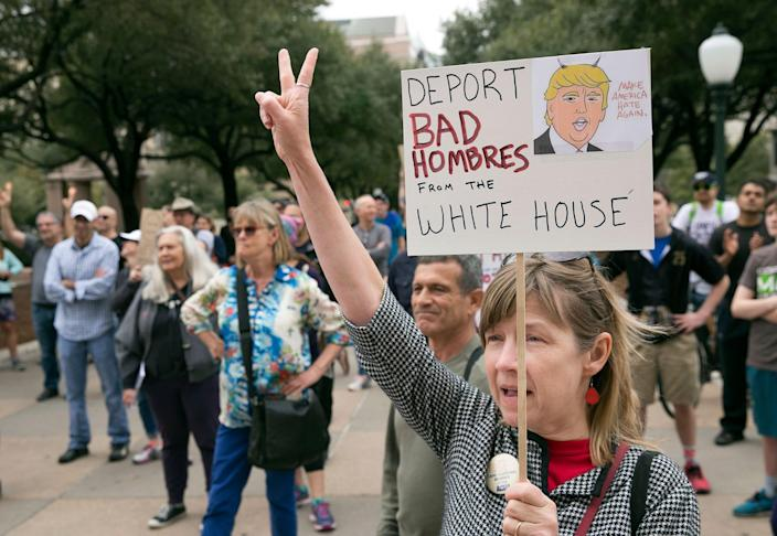 """<p>Jaime Shimkus participates in the """"Not My President's Day"""" rally at the capitol in Austin, Texas, Feb. 20, 2017. Protesters rallied against the policies of Donald Trump on Presidents' Day. (Jay Janner/Austin American-Statesman via AP) </p>"""