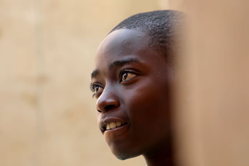 FILE PHOTO: Annas Shuaibu, a rescued student, looks on after he returned home in Kankara