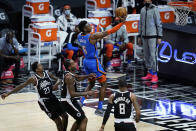 Oklahoma City Thunder guard Hamidou Diallo (6) shoots against Los Angeles Clippers forward Kawhi Leonard, bottom center, during the first quarter of an NBA basketball game Friday, Jan. 22, 2021, in Los Angeles. (AP Photo/Ashley Landis)