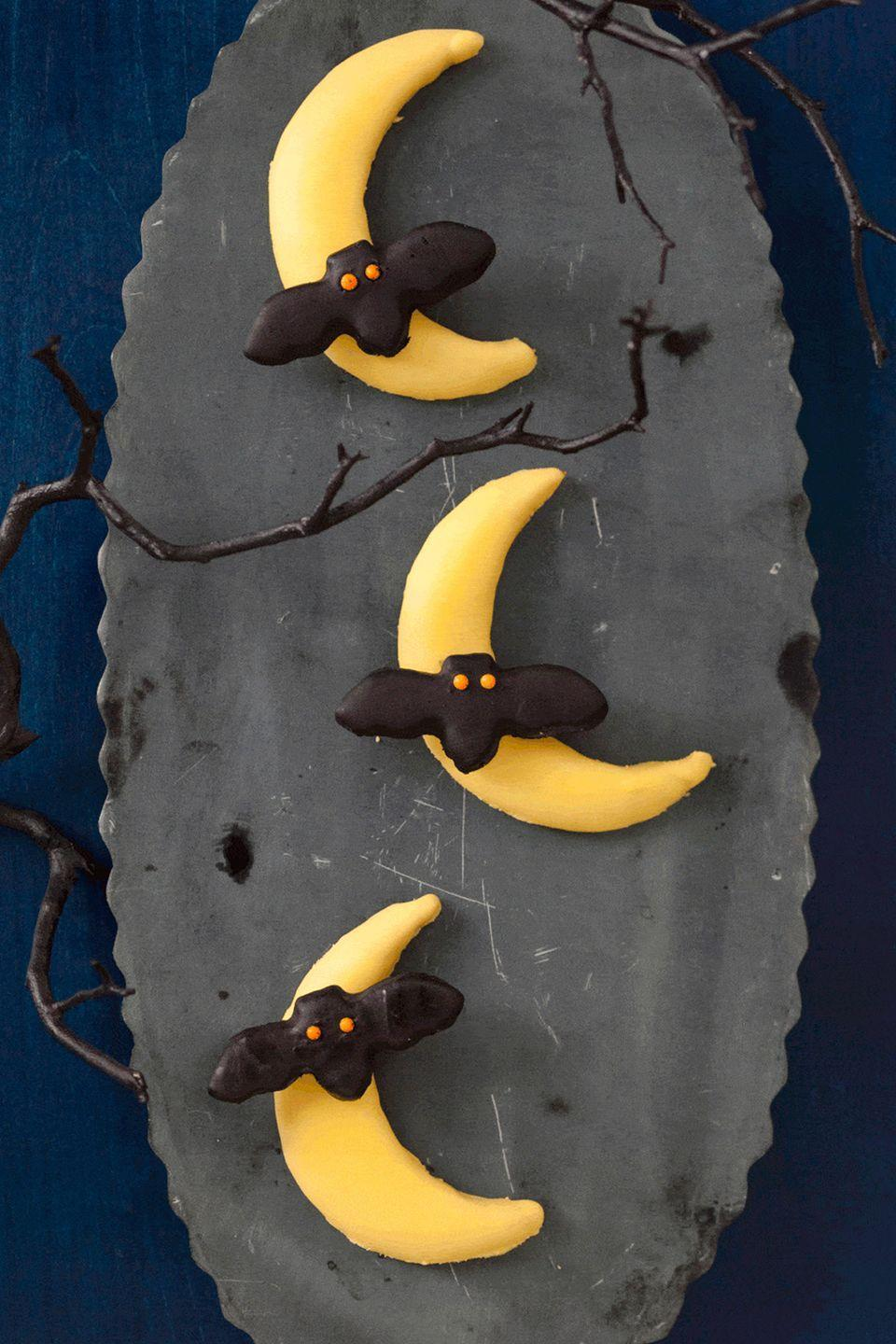 """<p>Bats are seriously underrated Halloween creature. Give them the attention they deserve with these eerie sweets.</p><p><em><strong><a href=""""https://www.womansday.com/food-recipes/food-drinks/recipes/a11390/bats-flying-across-the-moon-cookies-recipe-122707/"""" rel=""""nofollow noopener"""" target=""""_blank"""" data-ylk=""""slk:Get the Bats Flying Across the Moon Cookies recipe."""" class=""""link rapid-noclick-resp"""">Get the Bats Flying Across the Moon Cookies recipe.</a></strong></em></p>"""